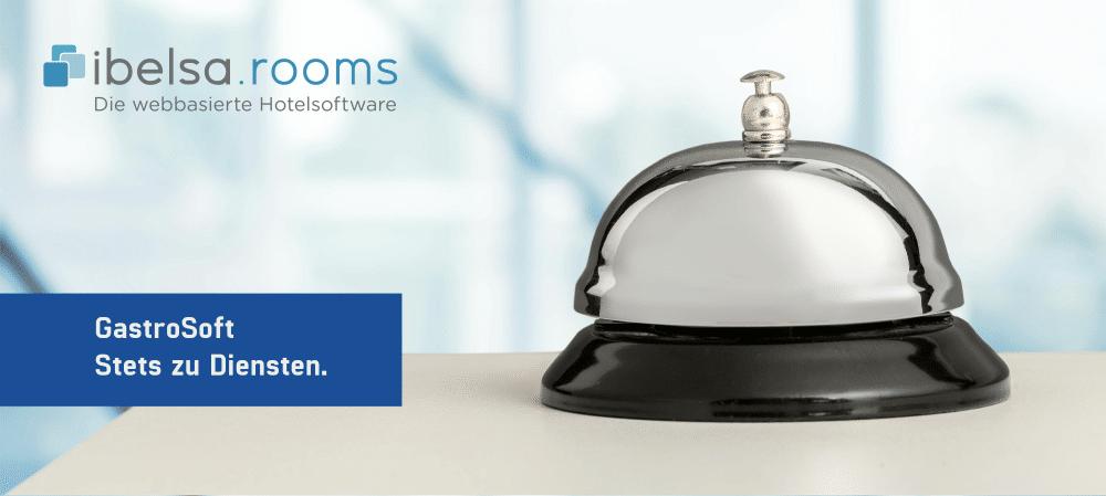 Silbern-schwarze Hotelglocke auf einem Tresen, ibelsa.rooms - Die webbasierte Hotelsoftware - GastroSoft Stets zu Diensten.