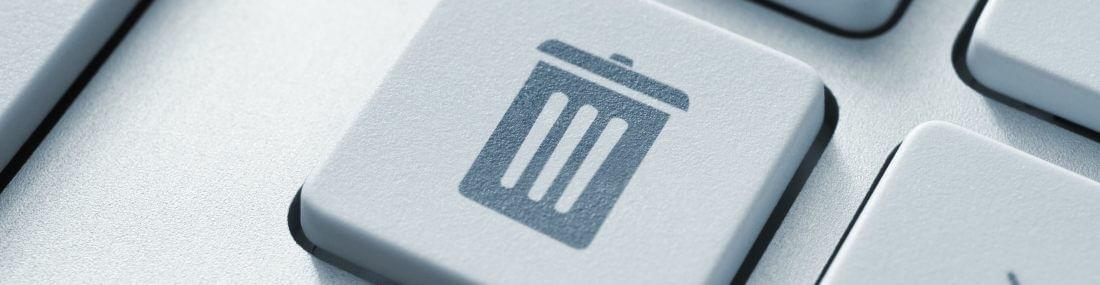 graues Papierkorb Icon auf einer weißen Taste: TSE Kassensystem, Kassensicherungsvorordnung 2020
